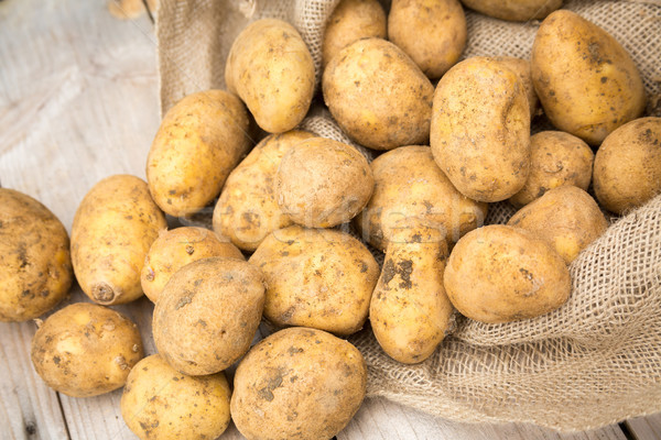 Potatoes Spilling out of Sack Stock photo © keeweeboy
