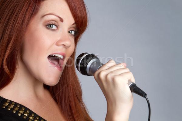 Singing Girl Stock photo © keeweeboy