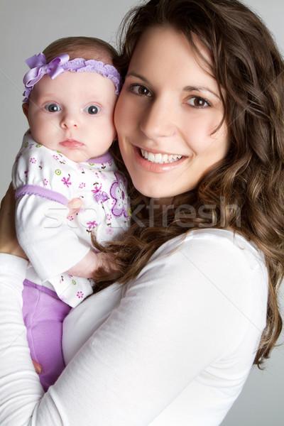 Mãe bebê sorridente feliz mulher família Foto stock © keeweeboy