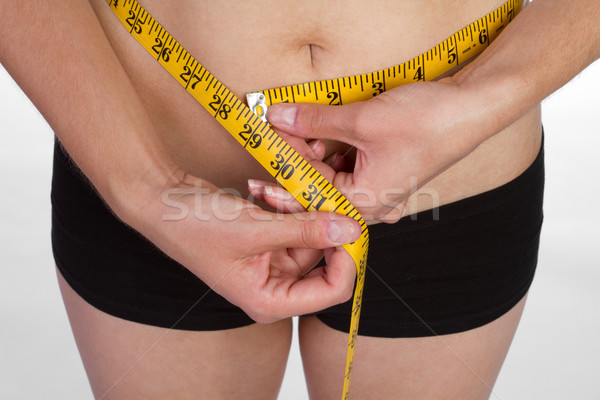 Woman Measuring Waist Stock photo © keeweeboy