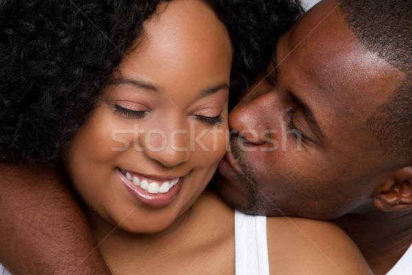 Paar zoenen zwarte meisje man vrouwen Stockfoto © keeweeboy