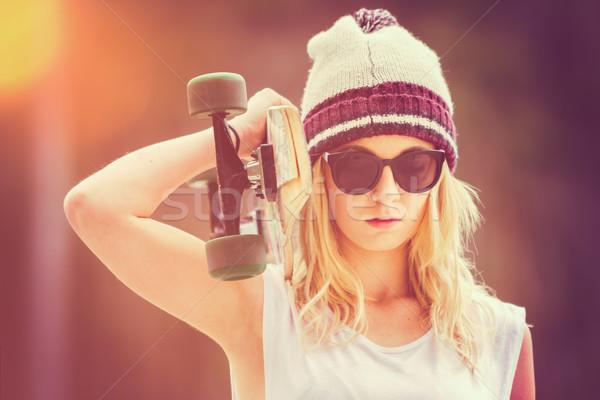Teen Girl Holding Skateboard Stock photo © keeweeboy
