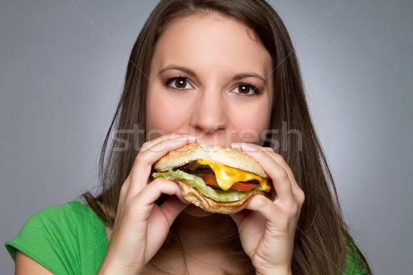 Fille manger hamburger belle fille alimentaire visage Photo stock © keeweeboy