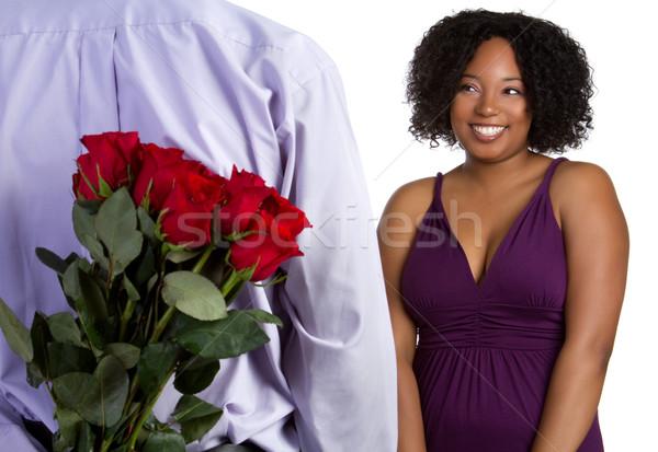 афроамериканец пару роз улыбка человека закрывается Сток-фото © keeweeboy