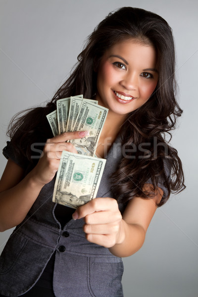 Woman Holding Money Stock photo © keeweeboy