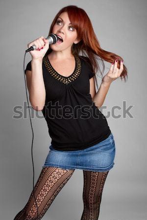 Redhead Singing Girl Stock photo © keeweeboy