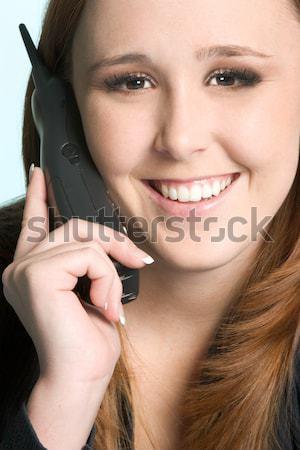 Komórka uśmiechnięta kobieta kobieta dziewczyna telefonu szczęśliwy Zdjęcia stock © keeweeboy