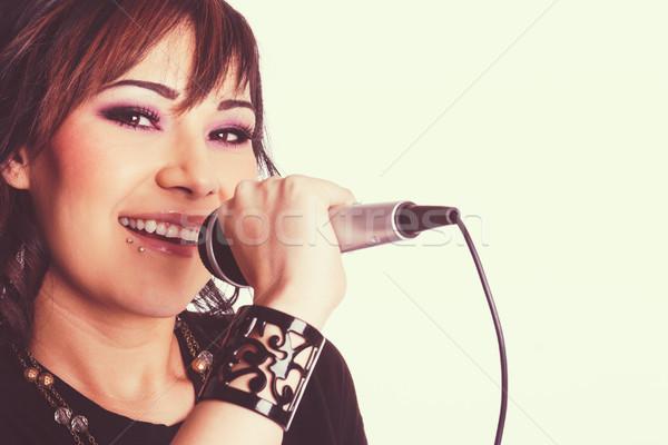 Singing Young Beautiful Woman Stock photo © keeweeboy