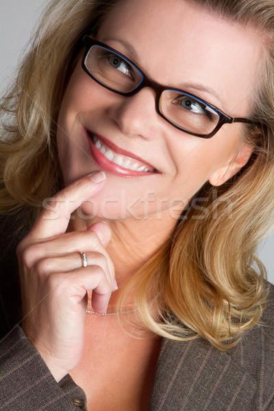 улыбаясь мышления женщину красивой улыбающаяся женщина лице Сток-фото © keeweeboy