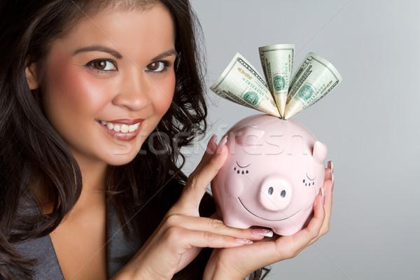Kumbara gülümseyen kadın para yüz Stok fotoğraf © keeweeboy