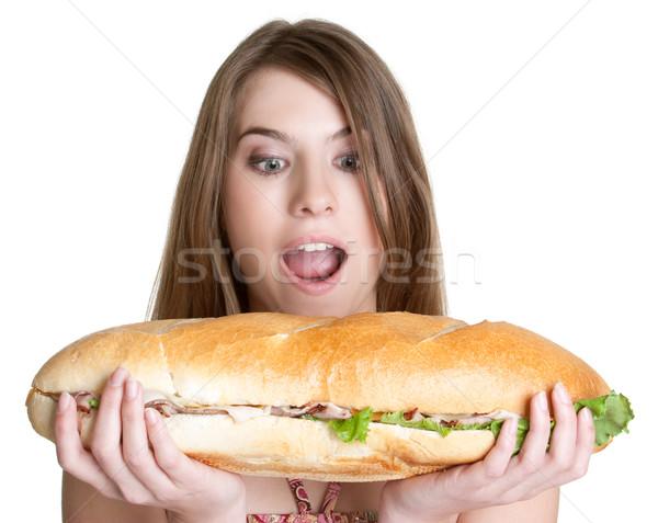 Ragazza mangiare alimentare isolato sandwich modello Foto d'archivio © keeweeboy