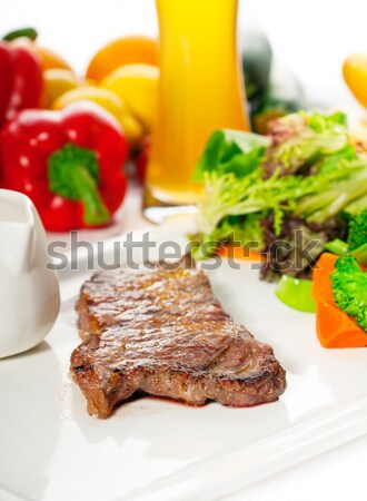 Stock photo: juicy BBQ grilled rib eye ,ribeye steak and vegetables