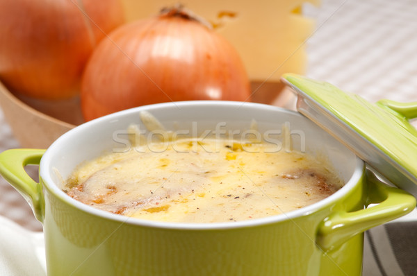 oinion soup with melted cheese and bread on top Stock photo © keko64