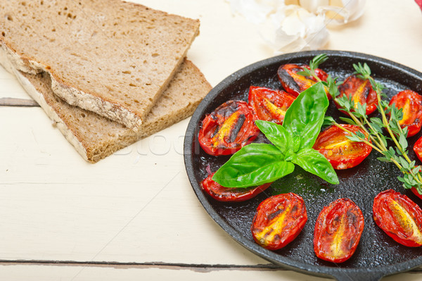 baked cherry tomatoes with basil and thyme Stock photo © keko64