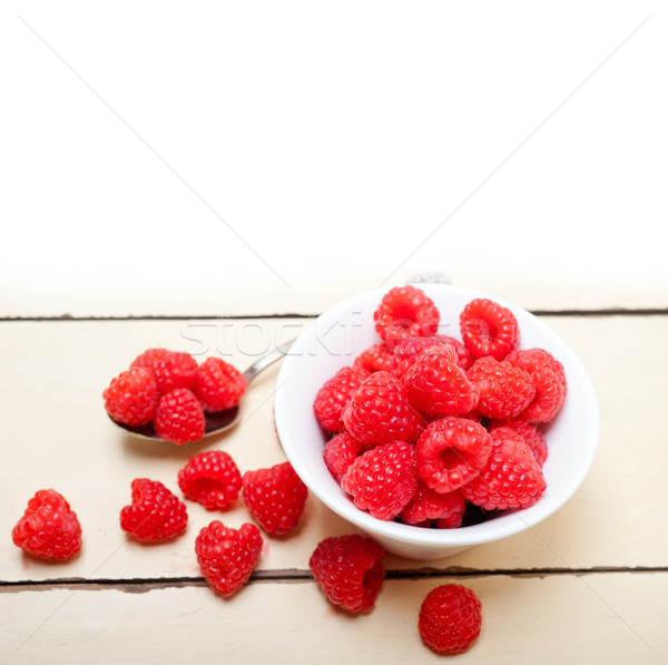 bunch of fresh raspberry on a bowl and white table Stock photo © keko64