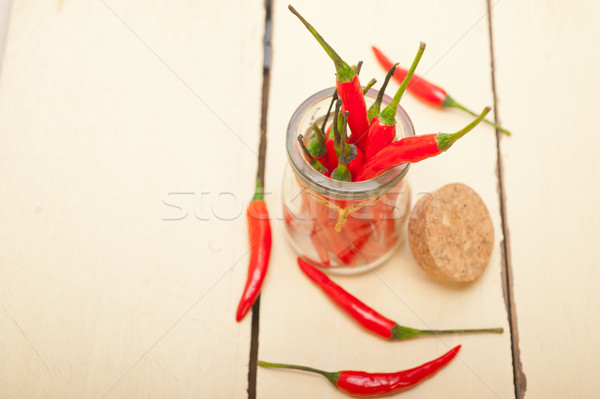 Stock photo: red chili peppers on a glass jar