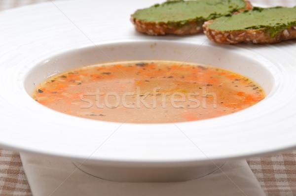 Italian minestrone soup with pesto crostini on side Stock photo © keko64