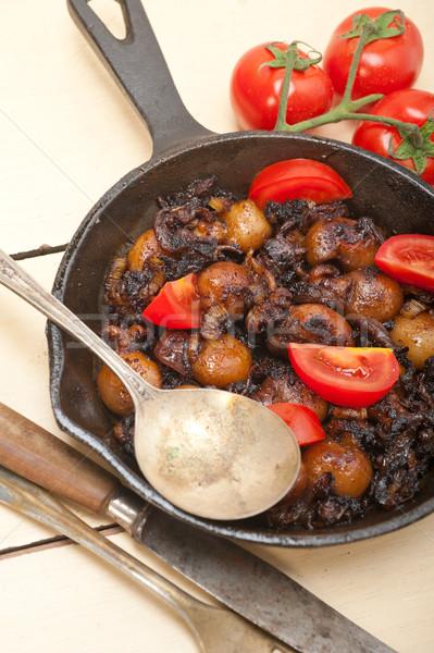 Baby cuttle fish roasted on iron skillet Stock photo © keko64