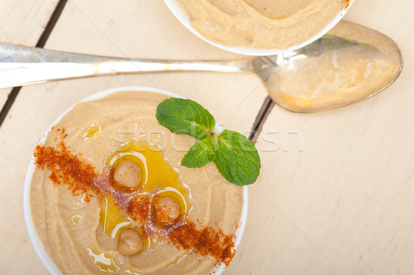 Hummus with mint on top Stock photo © keko64