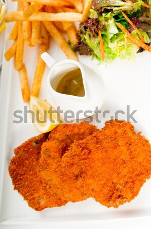 classic Milanese veal cutlets and vegetables Stock photo © keko64