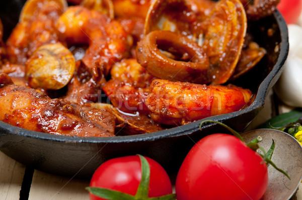 fresh seafoos stew on an iron skillet Stock photo © keko64