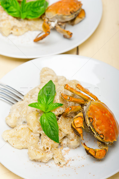 Italian gnocchi with seafood sauce with crab and basil Stock photo © keko64