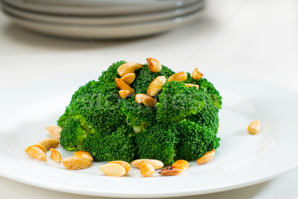fresh sauteed broccoli and almonds Stock photo © keko64