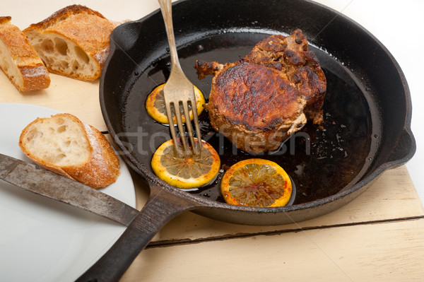 pork chop seared on iron skillet Stock photo © keko64