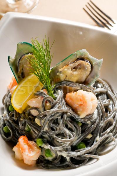 Сток-фото: морепродуктов · черный · спагетти · свежие · кальмар · чернила