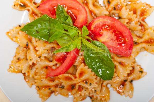 Italian pasta farfalle butterfly bow-tie and tomato sauce Stock photo © keko64