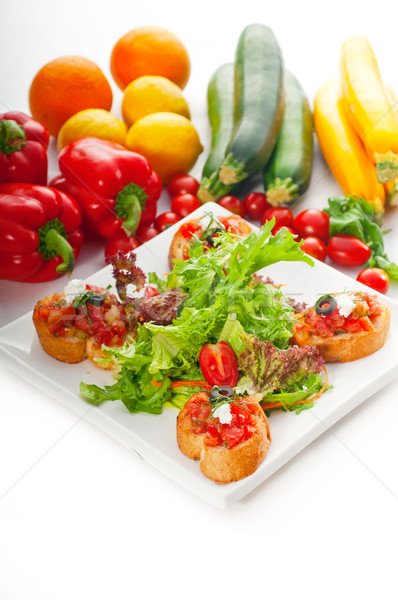 original Italian fresh bruschetta served with fresh salad and ve Stock photo © keko64