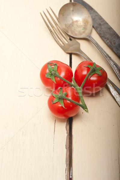 ripe cherry tomatoes over white wood Stock photo © keko64