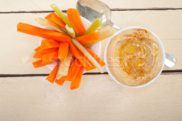 Stock photo: fresh hummus dip with raw carrot and celery