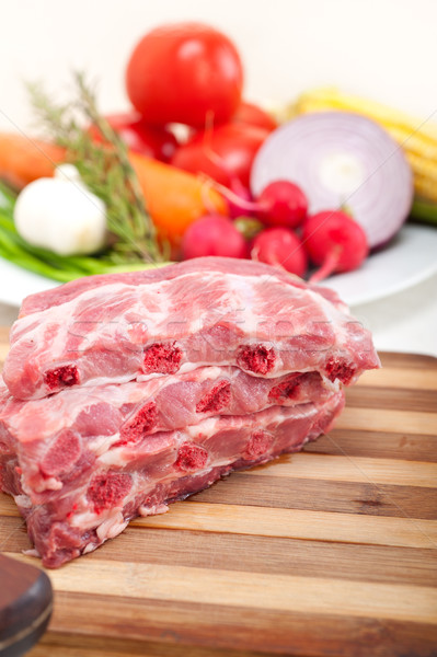 chopping fresh pork ribs and vegetables Stock photo © keko64