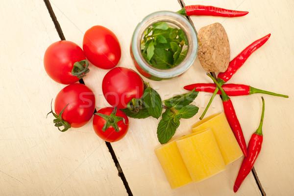 Italian pasta paccheri with tomato mint and chili pepper Stock photo © keko64