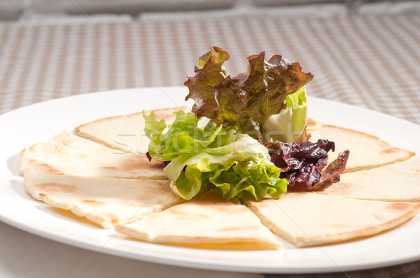 garlic pita bread pizza with salad on top Stock photo © keko64