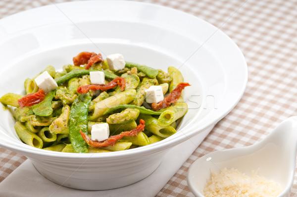 Italian penne pasta with sundried tomato and basil Stock photo © keko64