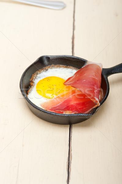 egg sunny side up with italian speck ham Stock photo © keko64
