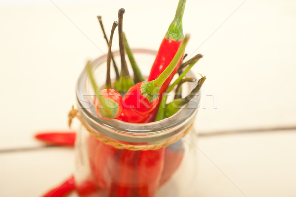 red chili peppers on a glass jar Stock photo © keko64
