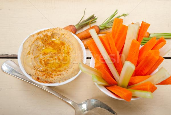 fresh hummus dip with raw carrot and celery  Stock photo © keko64