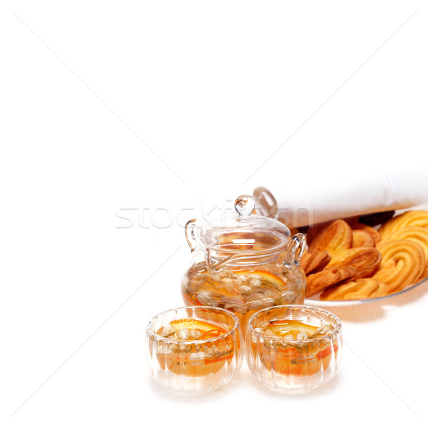 floral tea set and pastry assortment over white Stock photo © keko64