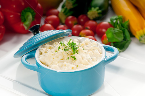 mac and cheese on a blue little clay pot Stock photo © keko64