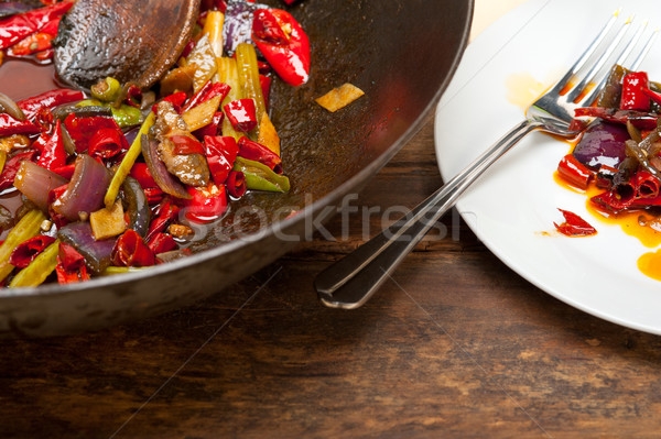 fried chili pepper and vegetable on a wok pan Stock photo © keko64