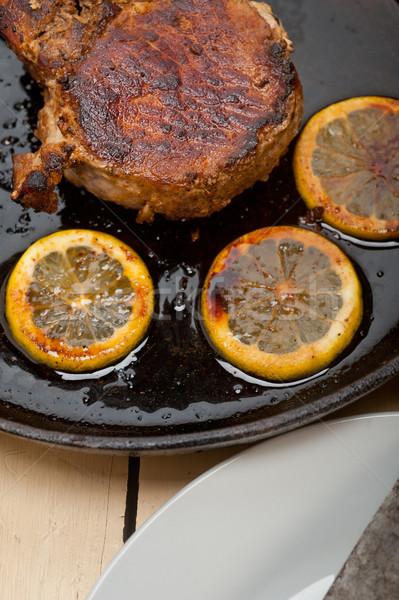 pork chop seared on iron skillet Stock photo © keko64