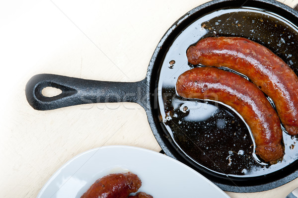 beef sausages cooked on iron skillet  Stock photo © keko64