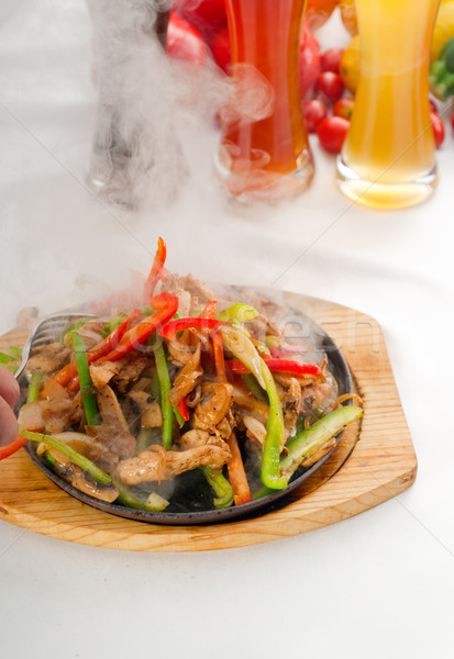 Stock photo: original fajita sizzling hot  on iron plate
