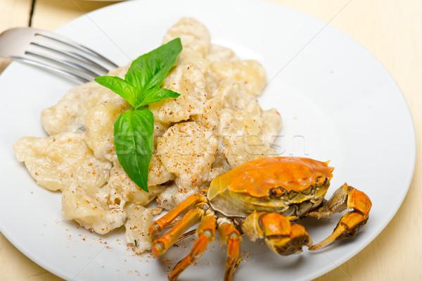 Italian gnocchi with seafood sauce with crab and basil Stock photo © keko64