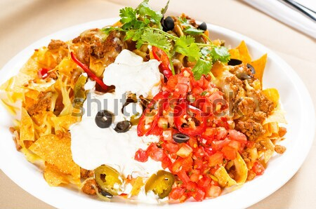 fresh nachos and vegetable salad with meat Stock photo © keko64