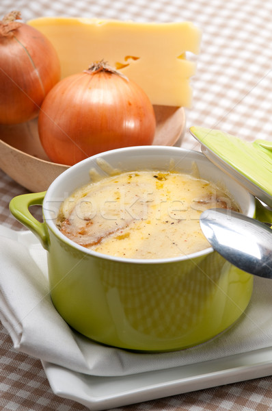 onion soup with melted cheese and bread on top Stock photo © keko64