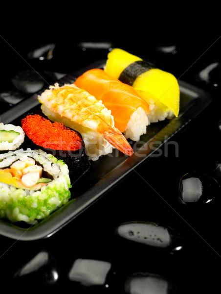 Stockfoto: Sushi · plaat · zwarte · vis · achtergrond